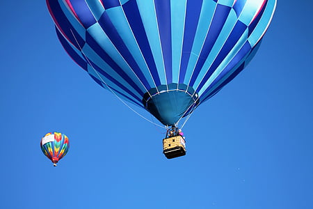 two blue, red, and white hot air balloons