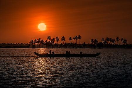 silhouette of canoe during sunset