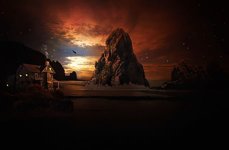 silhouette of rock formation during sunset