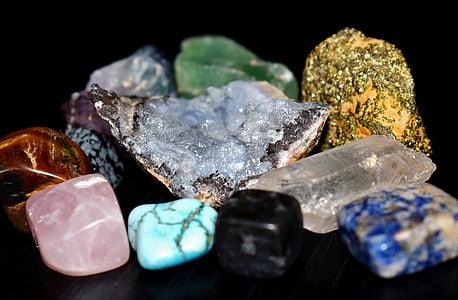 several assorted-color gemstones