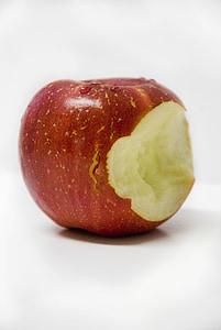 bitten red apple on white tabl