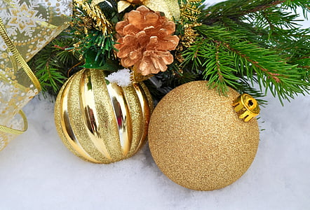 two gold Christmas baubles
