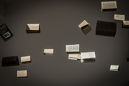 book floating on gray background wallpaper
