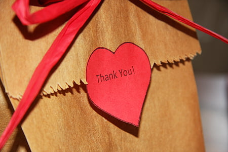 brown and red thank you printed envelop