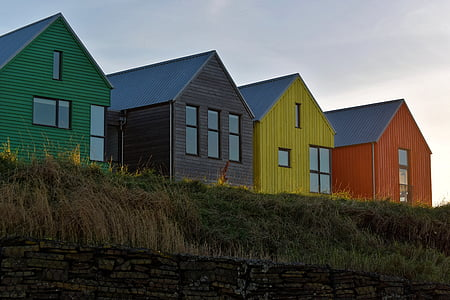 four assorted-color houses