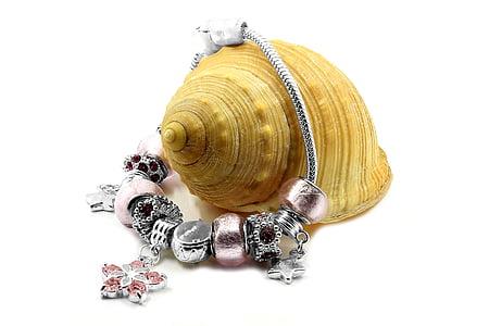 silver-colored charm bracelet