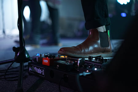 person using guitar effects