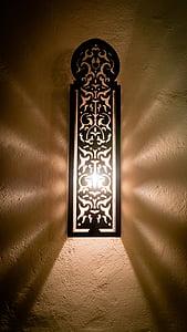 black wooden framed wall light