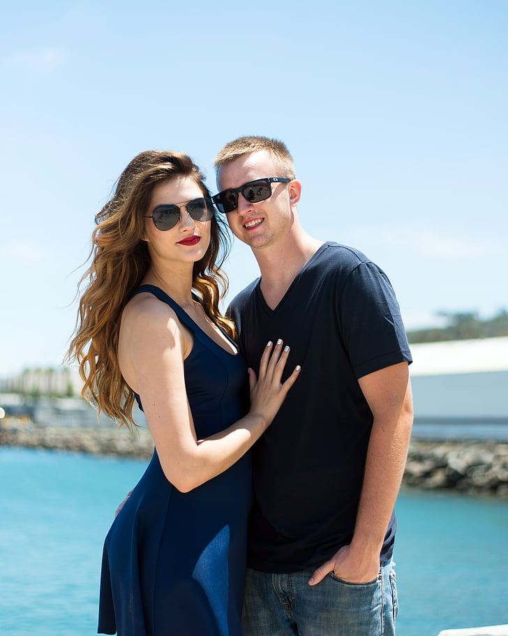 blue dressed woman beside man