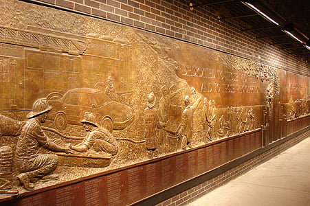 brown wooden wall with sculptures