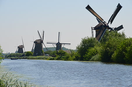 landscape photography of four windmills