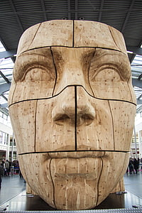 brown wooden statue of man's face