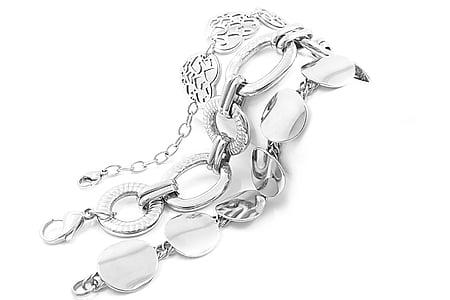 several silver-colored bracelets