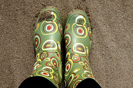pair of green-and-brown rain boots