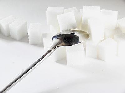 silver spoon on sugar cube