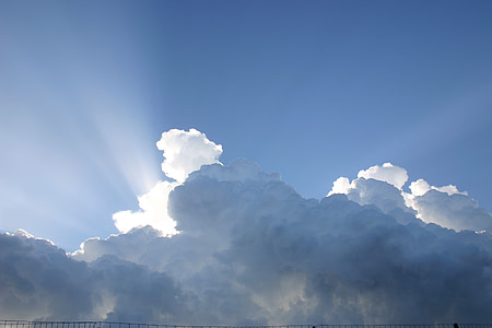 white clouds and crepuscular rays