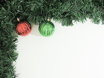 two red and green bauble on Christmas vines
