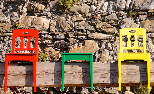 red, green, and yellow wooden chairs