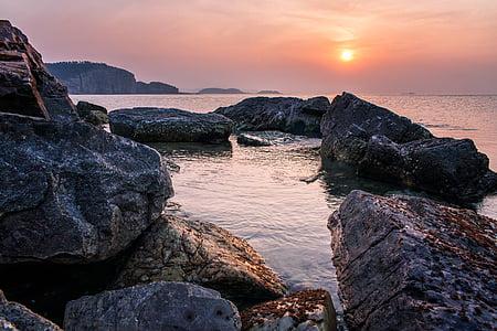 rocky shore during sundown