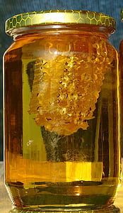 clear glass jar containing honey