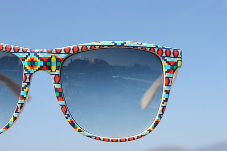 red, blue, and yellow framed Wayfarer-style sunglasses