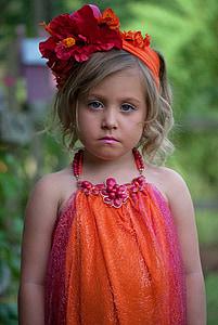 girl wearing sleeveless dress
