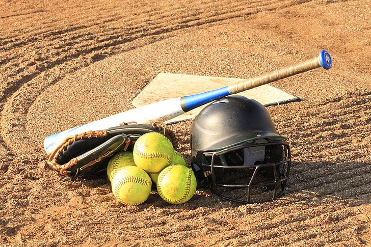 baseball bat beside baseball helmet