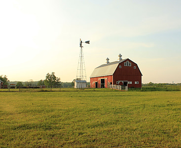 red barn in midst of green field
