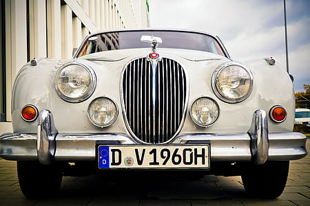 white Jaguar S-type with license plate D V1960H