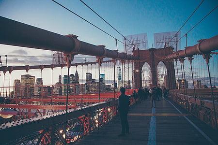 man on red bridge