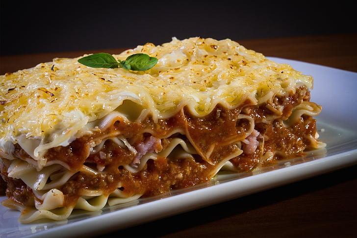 Lasagna on top of white ceramic plate